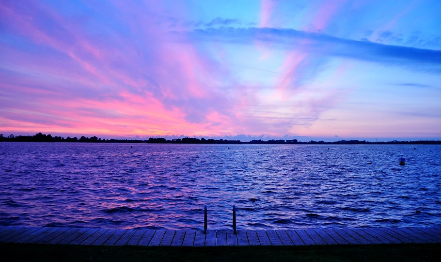Purple horizon over a lake wallpapers